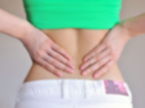 young-woman-is-having-a-pain-in-her-back