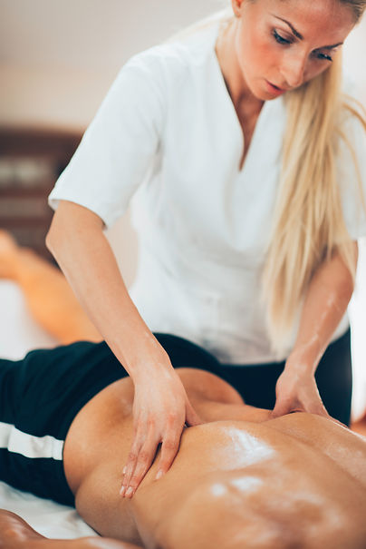 sports-massage-therapist-massaging-sport