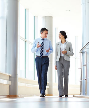 Confident business partners walking down