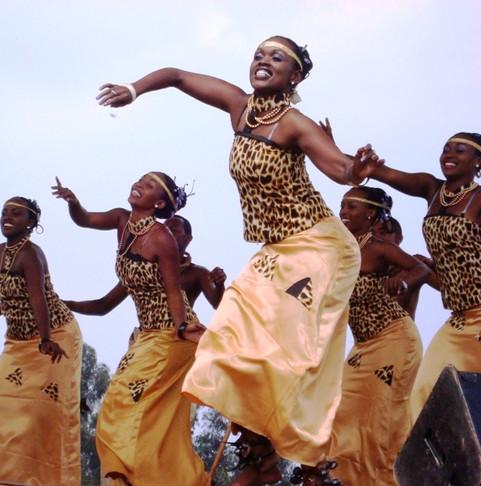 kwita izina women leaping 600.jpg