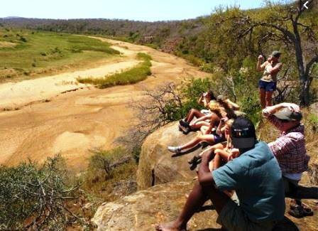 sitting on ledge of river.JPG.jpg