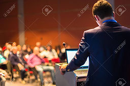 31814203-speaker-at-business-conference-