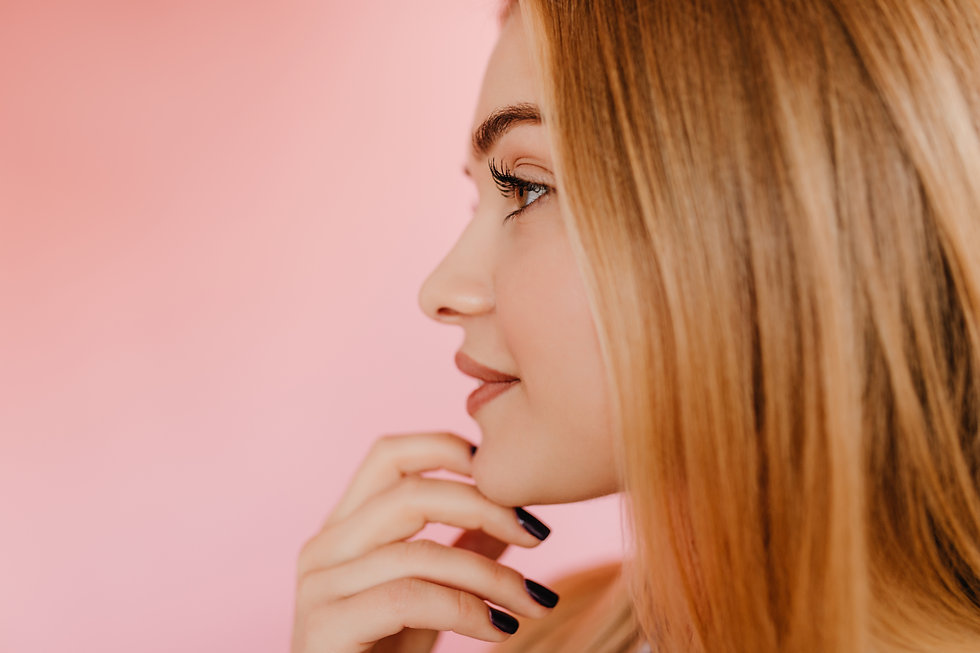 pensive-woman-with-long-eyelashes-standi