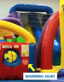 Obstacle course and warning sign that little kids without the strength should not get assistance to enter.