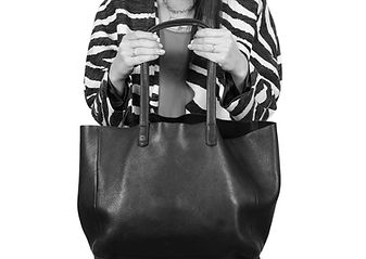 Woman holding purse black and white