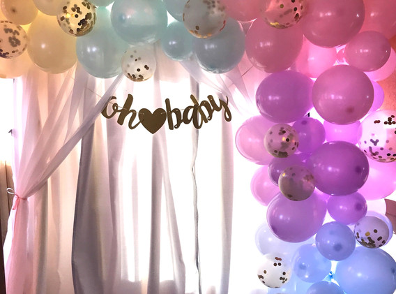 Gender reveal backdrop and balloon garland
