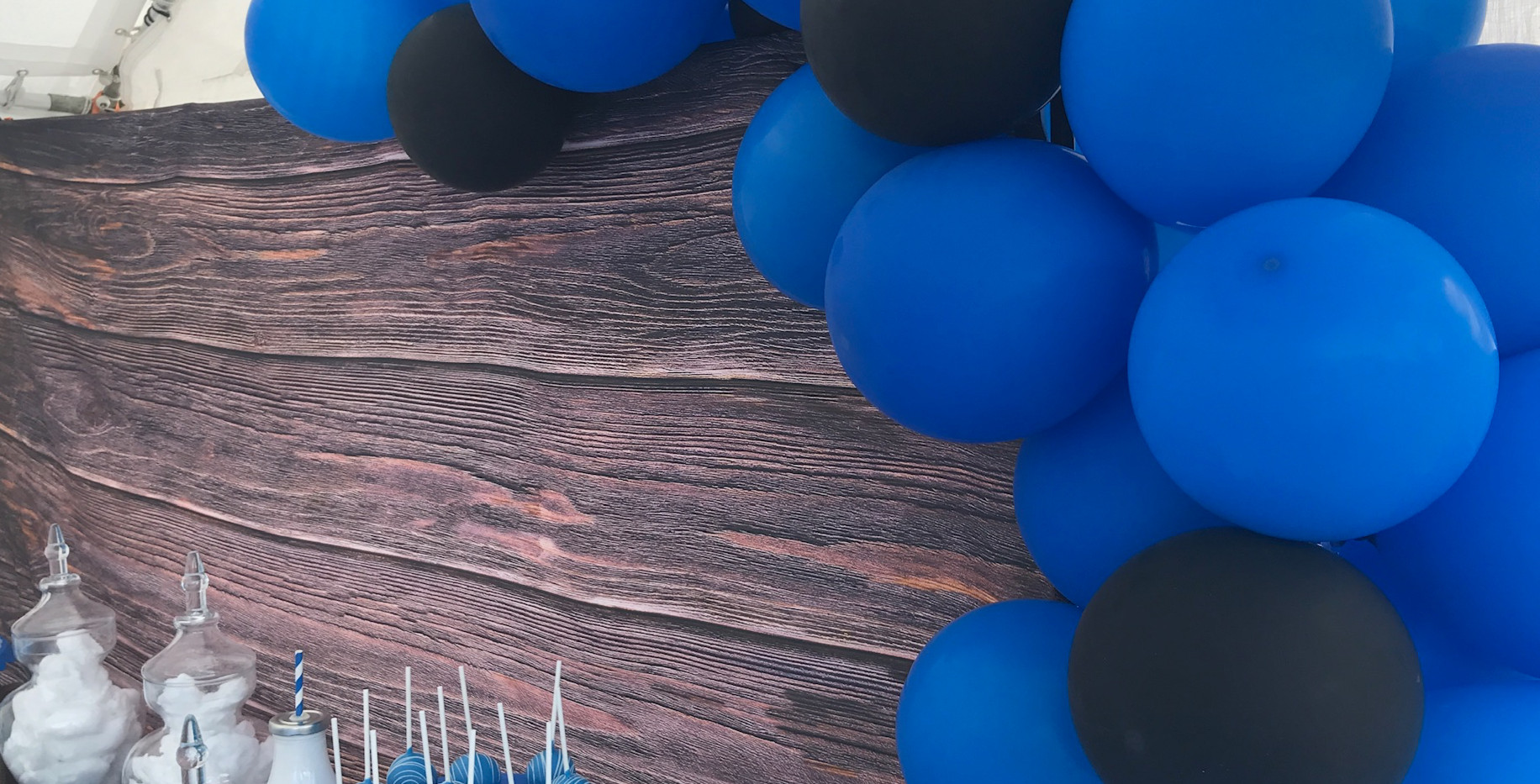 Vinyl wood backdrop with balloon garland