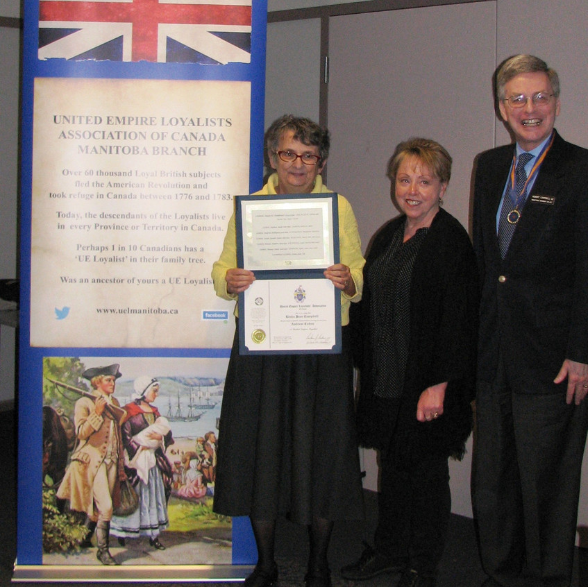 President Robert Campbell and Genealogist Alice Walchuk present Linda Campbell with her Loyalist Certificate