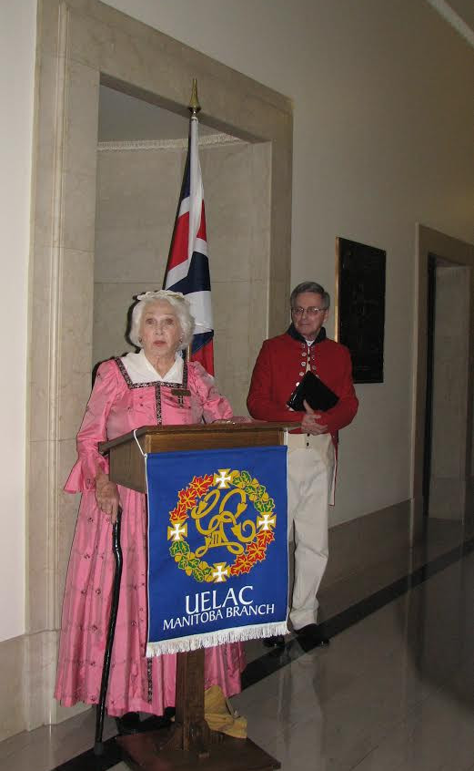 Margaret Carter speaks at the plaque rededication ceremony