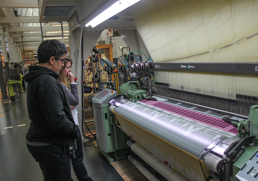 Weaving the Fabric of the Universe: How astrophysics and textiles are helping researchers shape dark matter | A weaving machine at the Textiellab