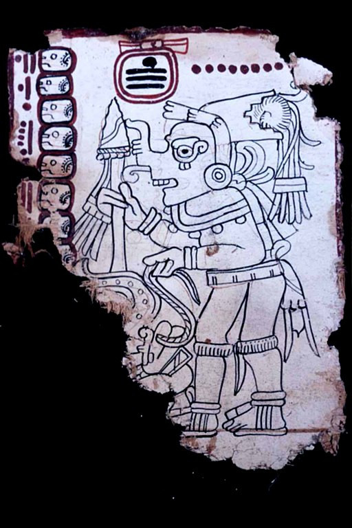 The Oldest Book in the Americas is a Mayan Guide to Astronomy | Page 4 (column L) This again appears to be God K, attired as a Toltec warrior. However, his headdress is very different from that of page 1, with a stepped-down element in which is fitted a downball from which stream quetzal plumes. Most of the figure of the captive whom he holds has been lost.