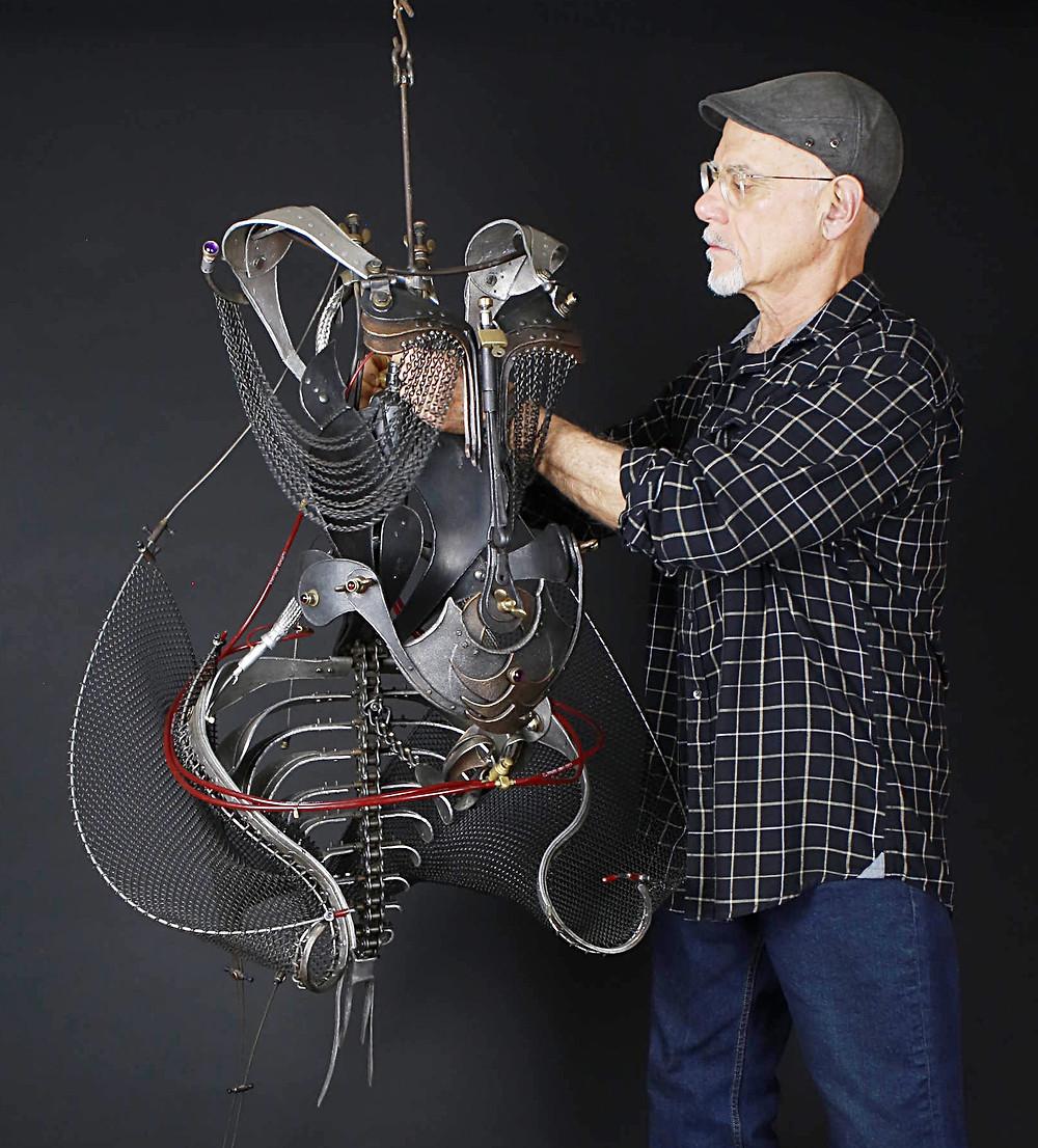 "Ira Sherman with his sculpture ""Scorpio 1F"""