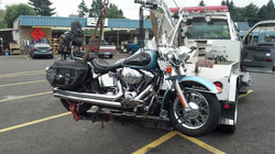 Damaged motorcycle towing