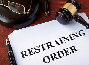 Restraining order and gavel on a table..jpg