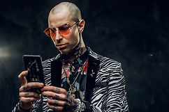 Charming, stylish, tattooed, bald male m