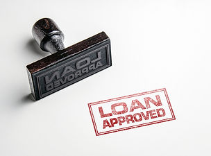Rubber stamping that says 'Loan Approved