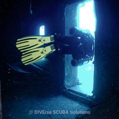 Sidemount Diver going Sideways