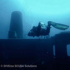 Sidemount Diver enjoying a shipwreck