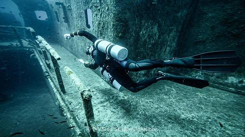 Sidemount Diver on side.jpg