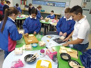 Grade 5s making sandwiches for Mandela D