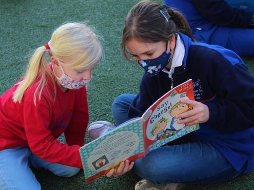 Grade 6s read to Grade Rs