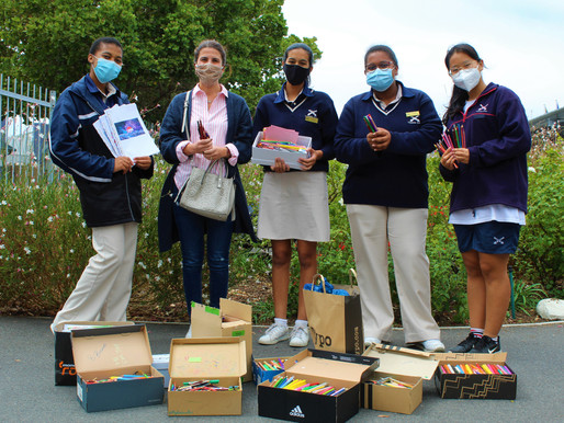 Cannons Creek Interact Society donate stationery to the needy