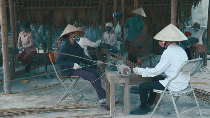 factory worker making amboo straws