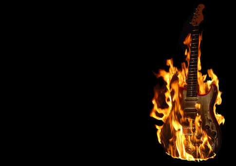 For this image I photographed an electric guitar on fire and decided that simplicity would be the key for this image, so I kept the image manipulation to a minimum.