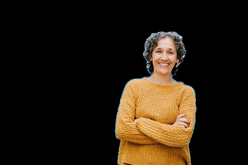 smiling-woman-in-orange-sweater-standing