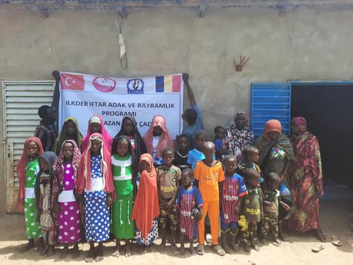 Çad'ın Abkoma köyünde 350 kişilik iftar,  adak ve gıda kolileri verildi.