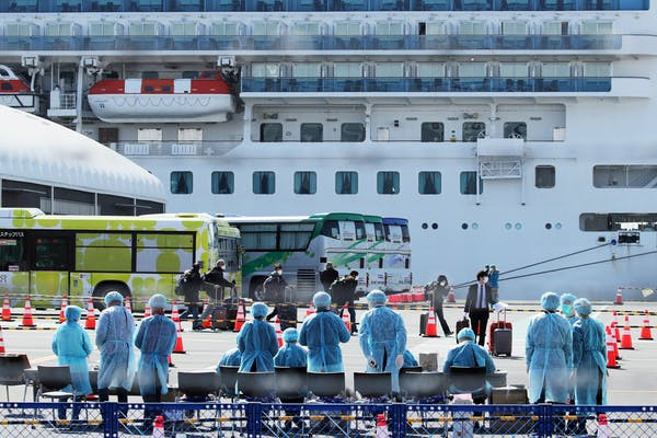 Waiting for passengers to disembark the Diamond Princess, which was quarantined in Japan