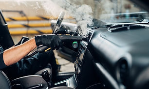 Steam cleaning car wash