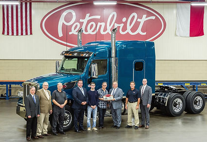 Peterbilt Motors Company presents the first production Model 567 Heritage to Rod Hinz and Alec Hinz of Hinz Trucking
