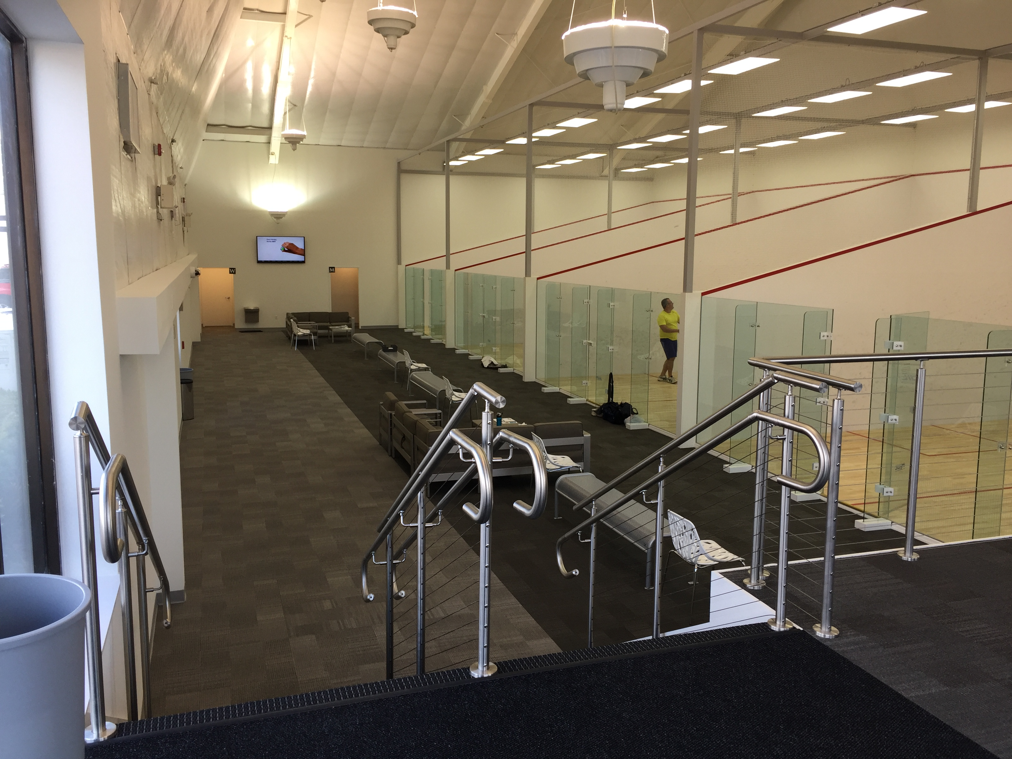 Squash club with cable guard railing