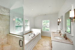 Master bath with creme marfil tile