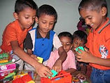 SL kids playing with toys.jpg