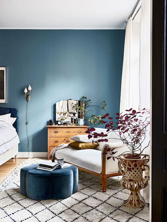 interior design trends_bedroom with one wall painted in a peaceful blue color