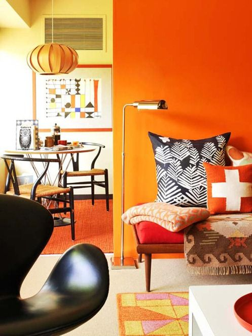 interior color trends_orange wall adds good energy to the living room