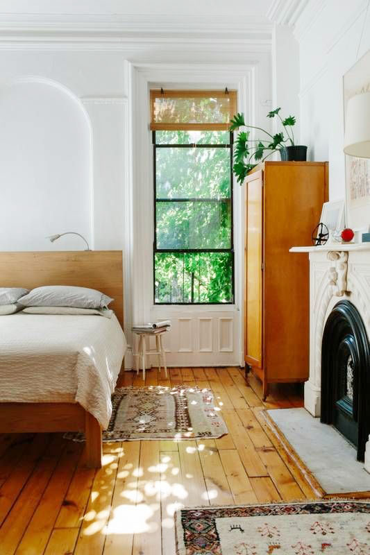 Interior design trends_white wall and solid wood floor with ceiling molding enliven this old house interior