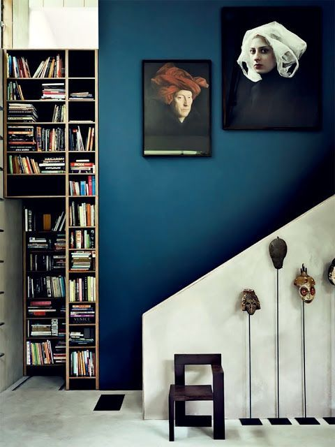 interior design trends_staircase with a wall painted in navy blue
