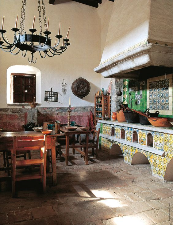 Spanish Colonial interiors, stucco walls, wrought iron chandelier