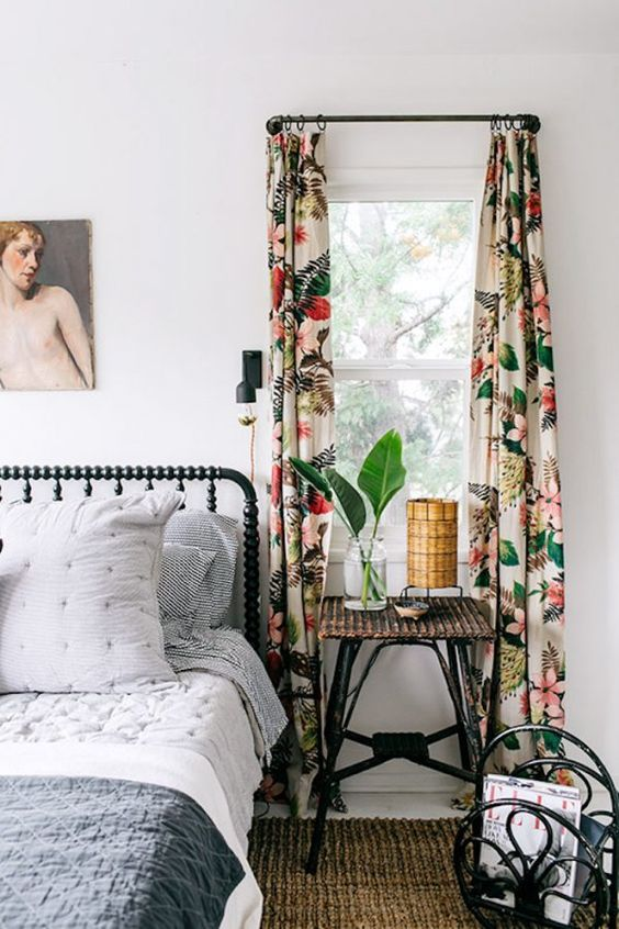 Bedroom interior decorator with a patterned curtain that echos the color in the wall frame.