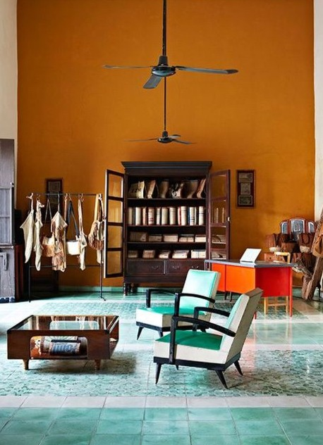 interior design trends_living room with a big wall painted in orange