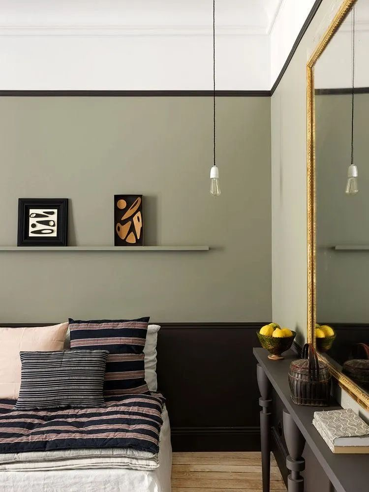 interior design trends_half painted wall in dull green adds details to this elegant bedroom