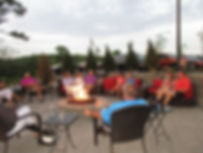 Members enjoying a nice evening by the fire pit.