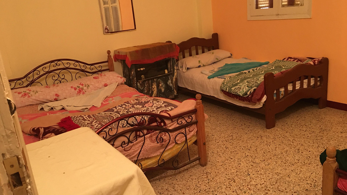 Another room with double beds and a private bathroom