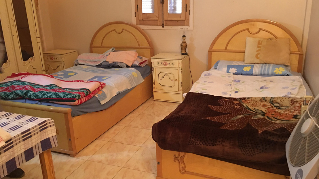One of the rooms with two beds and a private bathroom.