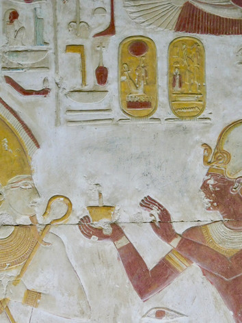 The king making an offering to the underworld god Osiris