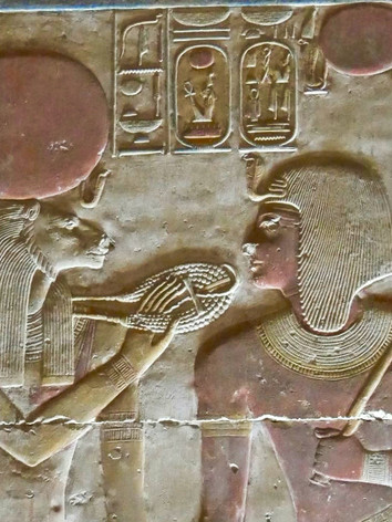 The goddess Sekhmet holds an Ankh symbol (life) intwined into her menat neclace (protection) to the king Seti I's mouth, from the Seti I Temple.