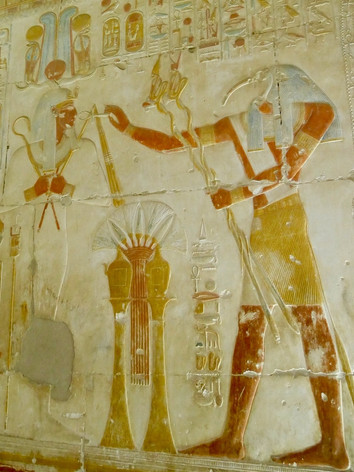 Thoth carrying magical snake wands from inside of the Seti I temple